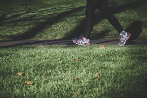 legs-walking-on-grassy-trail
