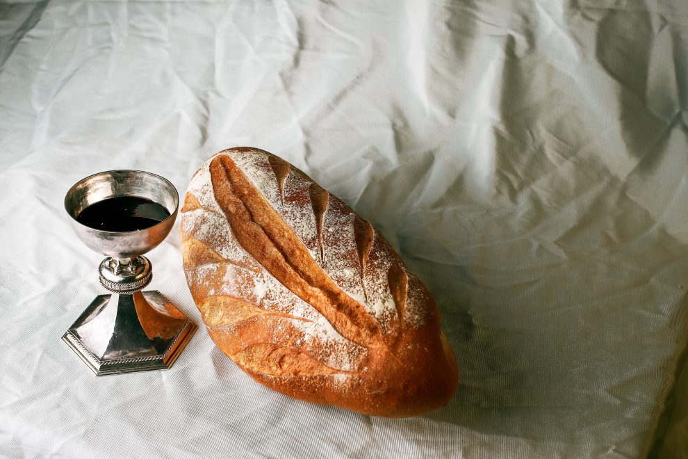 bread-and-wine-on-white-tablecloth
