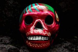 skull-painted-magenta-blue-green