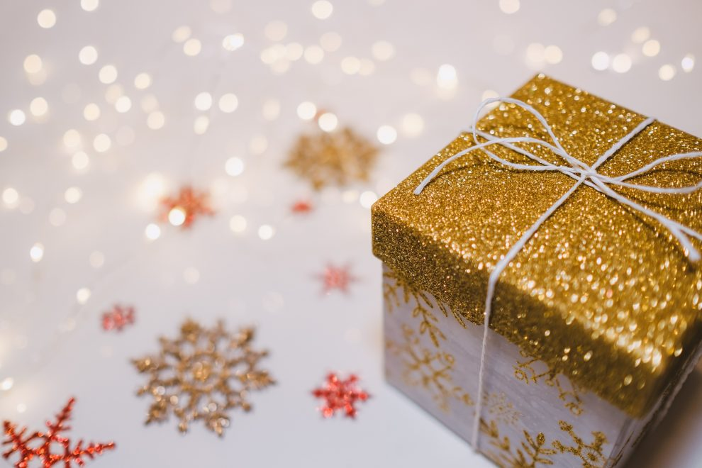 gold-present-amid-sparkly-snowflakes