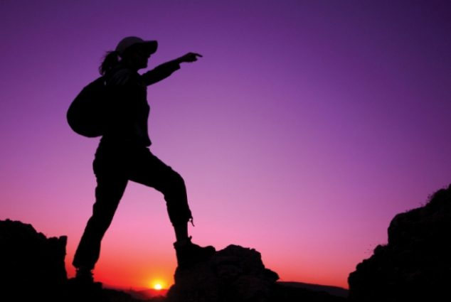 silhouette-of-woman-climbing-on-rock