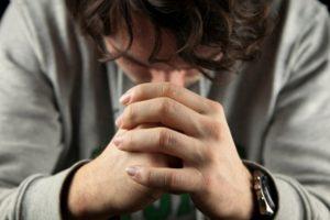 man-folding-hands-in-prayer