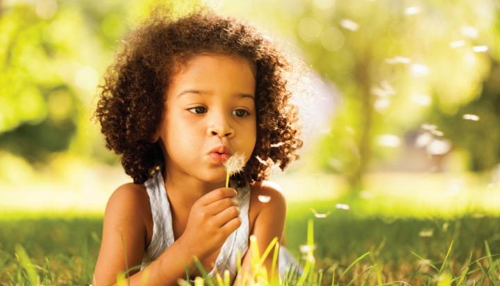 little-girl-blowing-dandelion