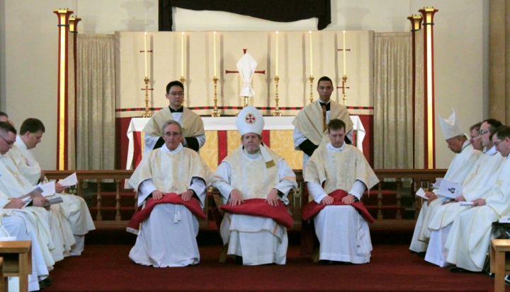deacons-sitting-at-altar