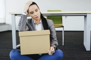 upset-woman-with-box-of-possessions