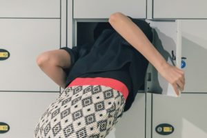 woman-with-her-head-in-a-locker