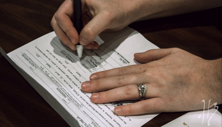 signing marriage license_Flickr