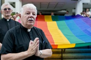 priests and LGBT flag_flickr