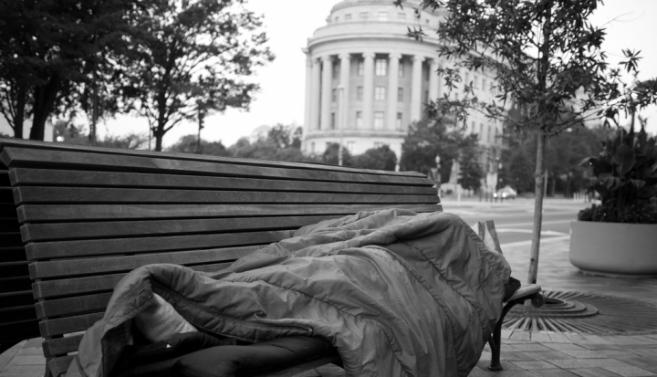 homeless-person-sleeping-on-bench