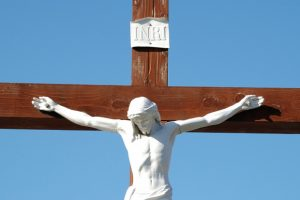 statue-of-christ-on-a-crucifix-with-a-blue-sky