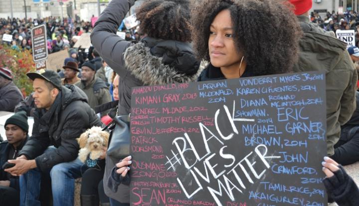 person-holding-black-lives-matter-sign