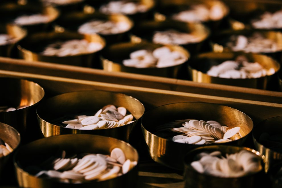 golden-ciboriums-filled-with-hosts-for-eucharist