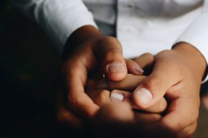 two-people-holding-hands