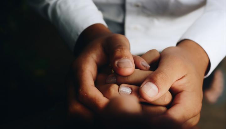 holding hands trans child essay