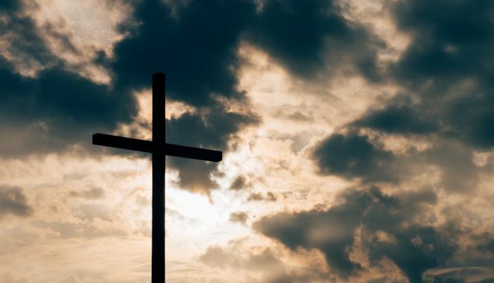cross-against-cloudy-sky