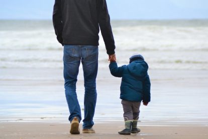 father-and-son-hold-hands