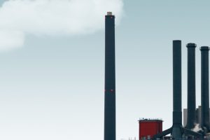 factory-smokestack-in-front-of-a-blue-sky