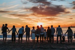 a-group-of-people-against-sunset