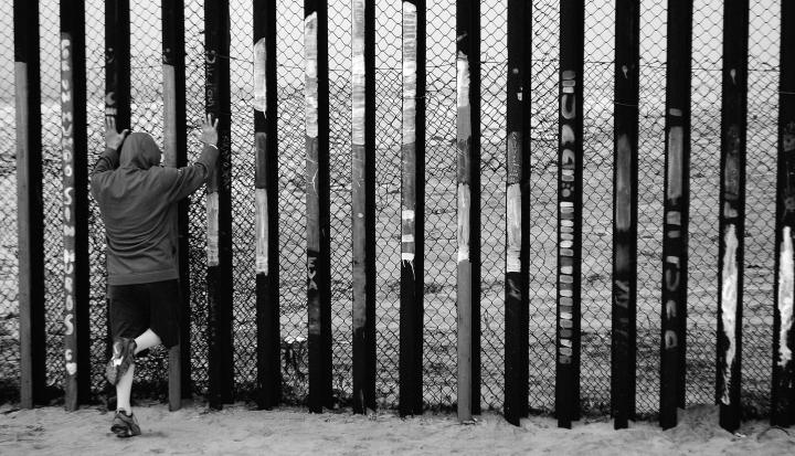man-at-border-fence