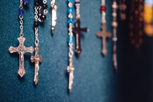 rosary-beads-against-blue-wall