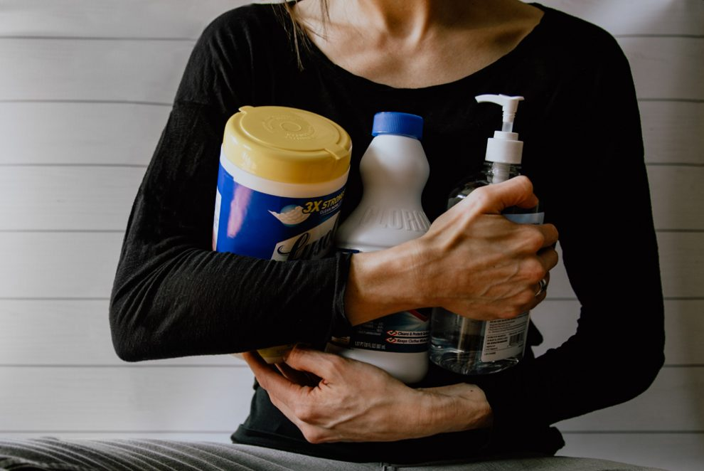women-holding-cleaning-supplies