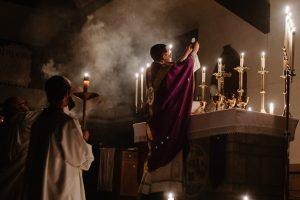 priest-raises-eucharist
