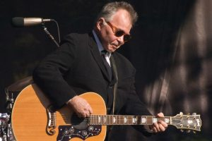 john-prine-playing-guitar