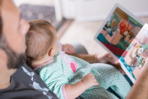 father-and-baby-read-board-book