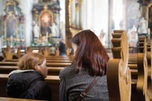 Woman-with-daughter-at-church