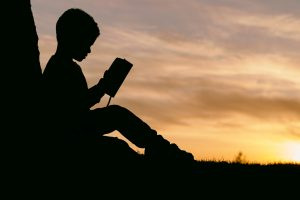 silhouette-of-child-reading