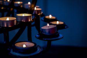 votive-candles-flicker-in-dark