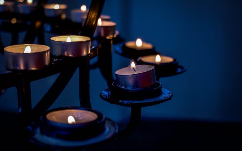 votive-candles-flicker-in-dark