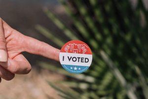 hand-holds-voting-sticker