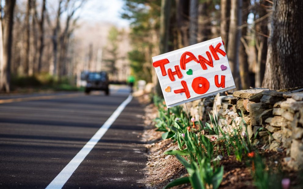 car-drives-by-sign-reading-thank-you