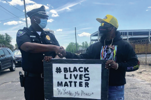 police-officer-and-black-lives-matter-protester-shake-hands