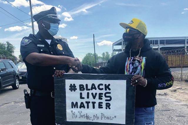 police-officer-and-black-lives-matter-protester-shake-hands