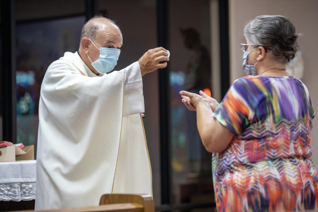 fr-ron-foshage-giving-communion-during-pandemic