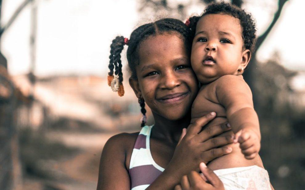 black-woman-holding-infant-child
