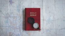 bible-and-compass-on-a-map