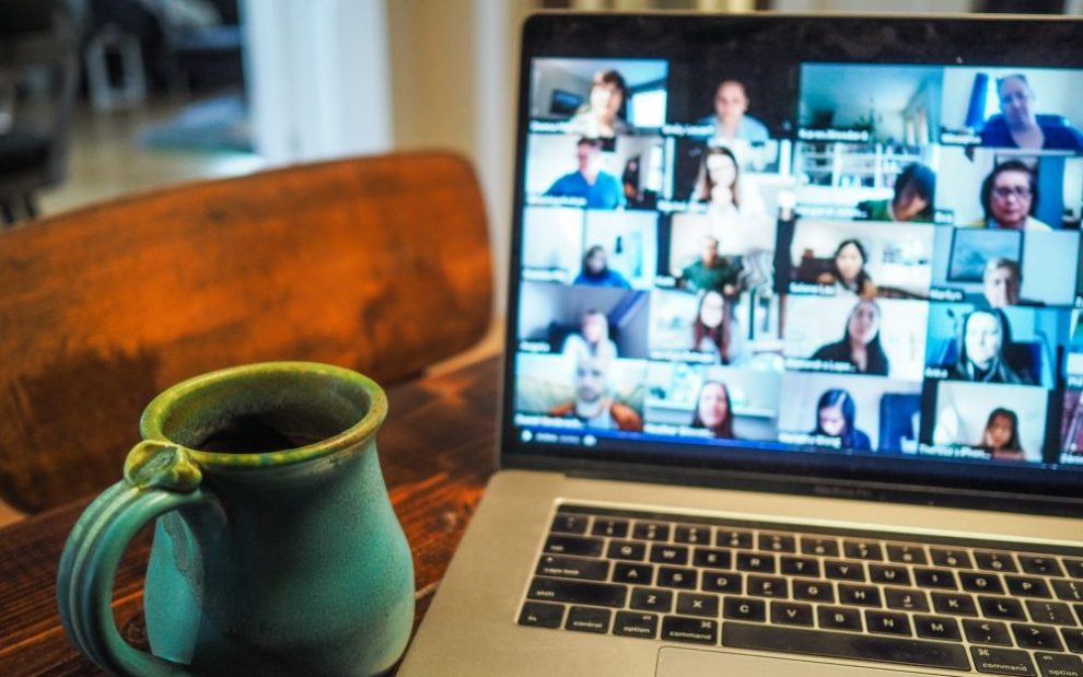 person-with-laptop-screen-showing-zoom-meeting
