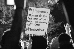 people-holding-up-black-lives-matter-sign-at-protest