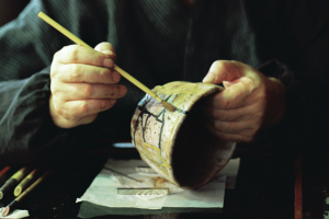 man-using-kintsugi-to-repair-a-broken-bowl