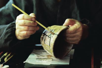 man-using-kintsugi-to-repair-a-broken-bowl