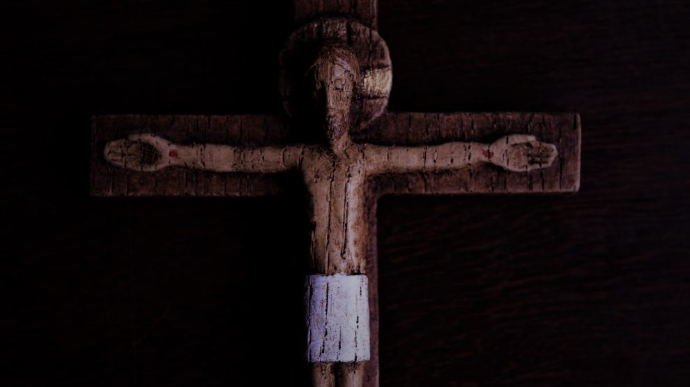 wooden-crucifix-dimly-lit