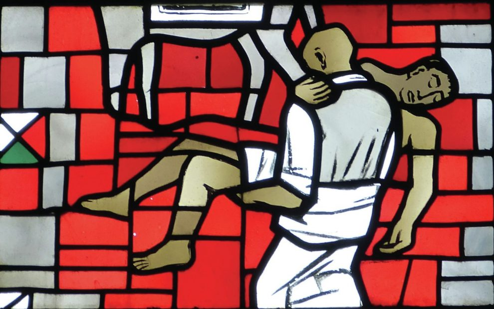 stained-glass-window-showing-one-man-carrying-another