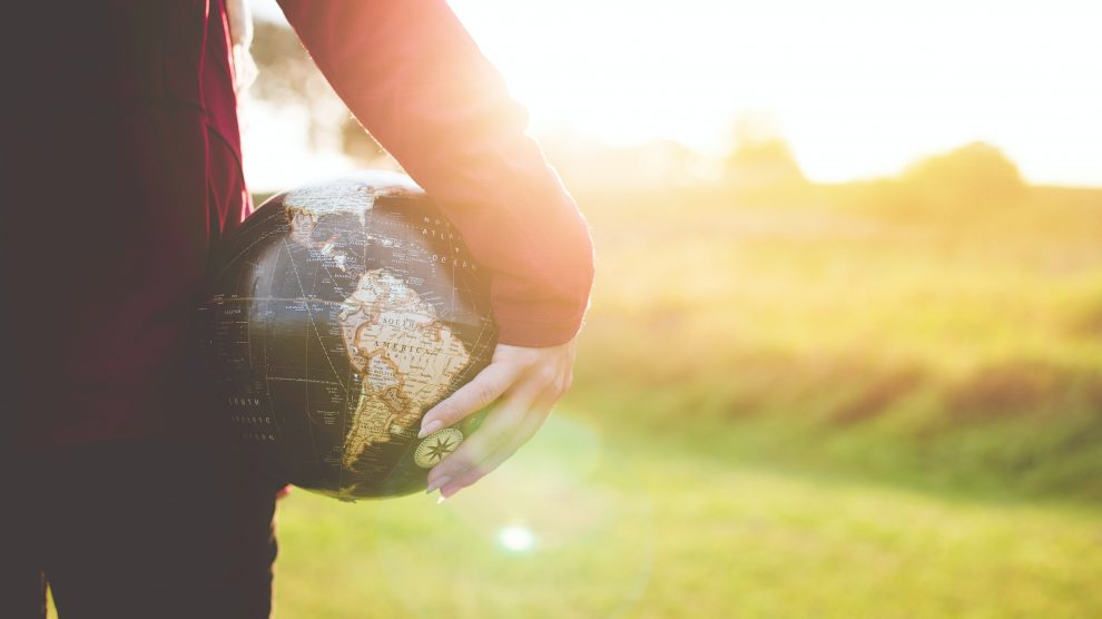 person-holding-globe-outdoors