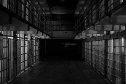 empty-hallway-of-prison-cells