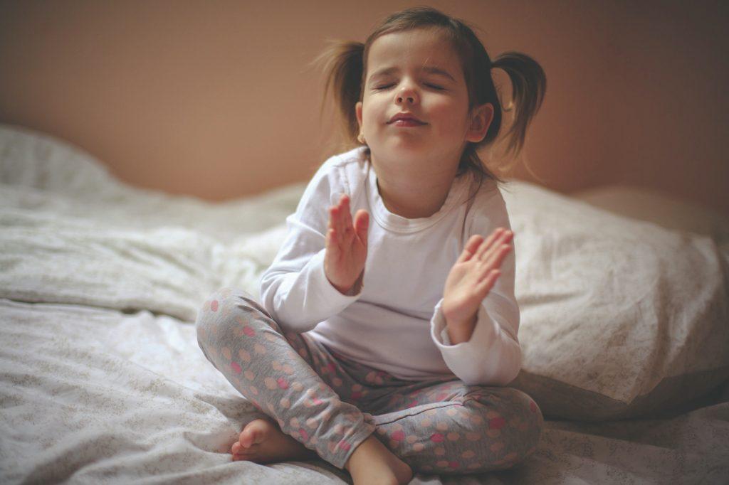 toddler-raising-hands-for-bedtime-prayer