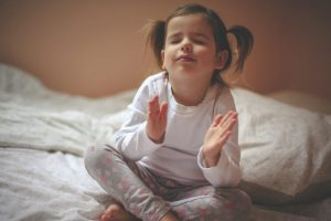 toddler-raising-hands-for-bedtime-prayer