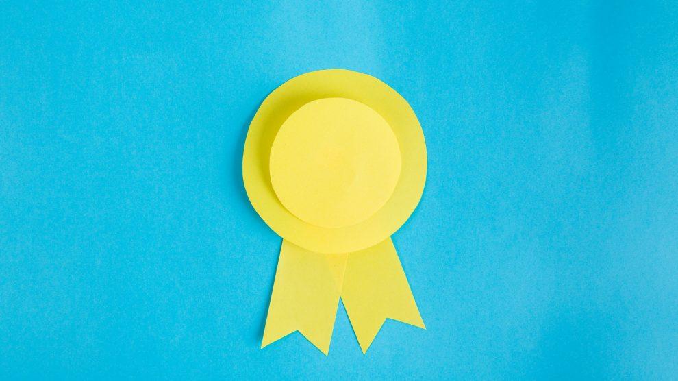 yellow-paper-ribbon-blue-background